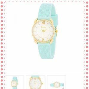 Jewelry - Goldtone mint rubber fashion watch.
